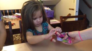 Girls opening Troll blind bags