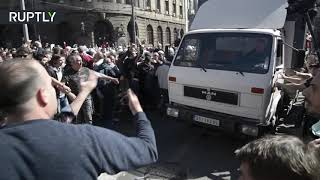 Serbian protesters use truck to break through police cordon & block presidential palace