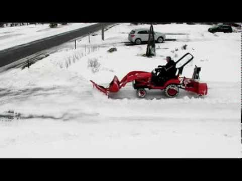 Security camera  view Kubota BX plowing and blowing snow