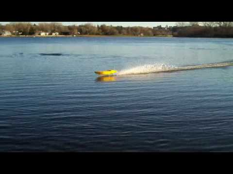 Howard takes the controls of Jim's go fast boat