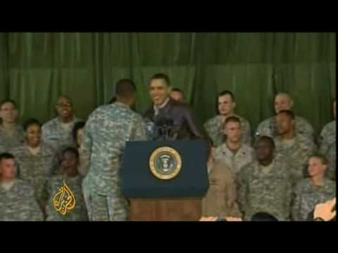 Obama tells Karzai to combat graft in surprise Afghan visit