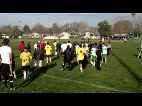 Brawl at CCSL soccer match in Dixon,Ca. Indios Dixon vs Academica.  Fan gets hit.