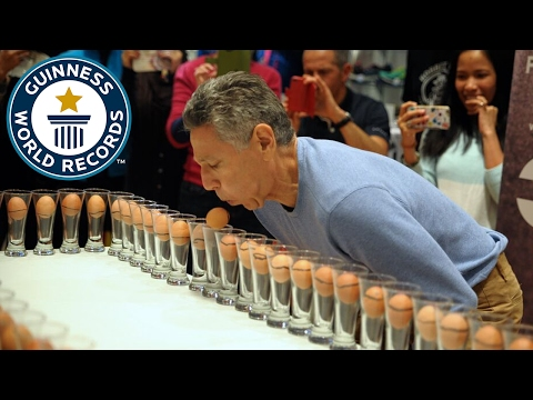 Most eggs in cups blown upside down in one minute - Guinness World Records