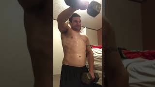 Shoulder raises - front delts - dumbbells - repping - muscle - home workout - bodybuilding - weights