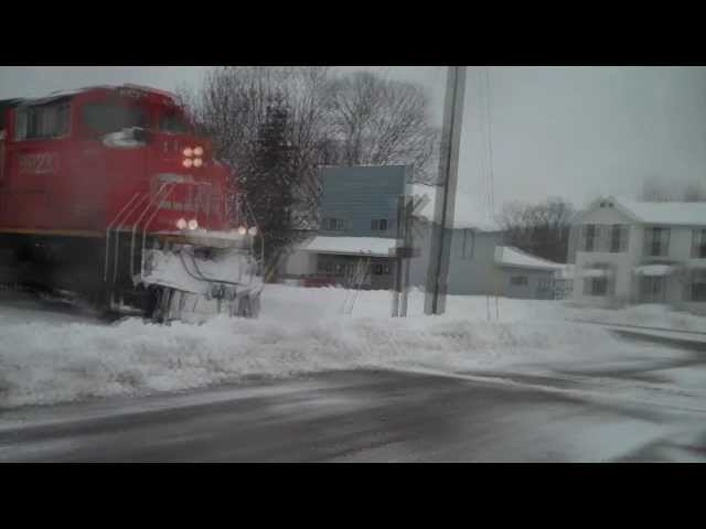 CN Train plows through a snow bank in Stephenson, Michigan