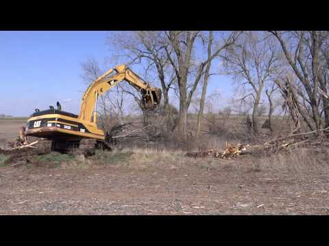 CAT 345 BL Series II Excavator taking out trees