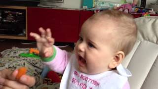 Baby eats actual food for the first time with partial succe