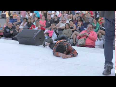 Kid passes out on stage of street performer