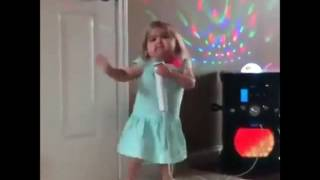 very little cute baby girl dancing and singing