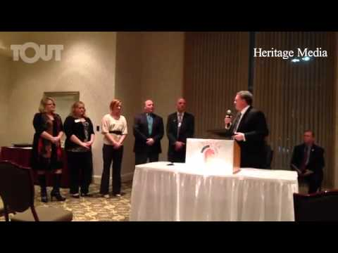 County Commissioner Kent Martinez-Kratz gives proclamation Chelsea Comfort Inn & Village Conference