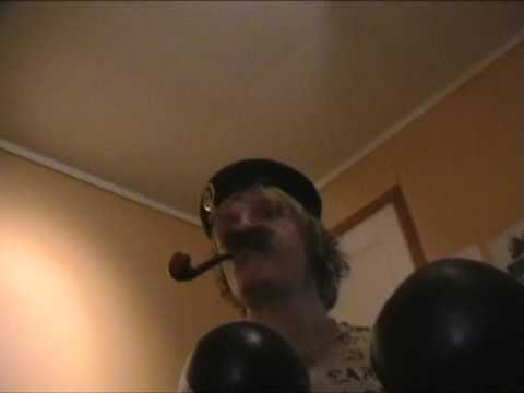 NOT SMOKING BIG SCHIRWITZ PIPE TOBACCOS  WITH CAMOUFLAGE CLOTHE, MILITARY BERET, BOXING GLOVES  AND JEANS  WITH JAG THEME SONG
