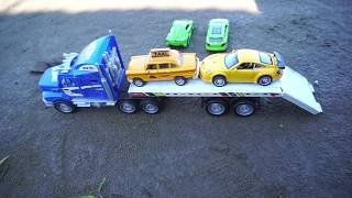 Video about Toy Cars being transported by Truck / Car Toy For kids