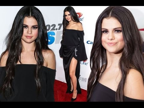 Selena Gomez leg bombs AND goes braless in sexy silk dress for Jingle Ball thumbnail
