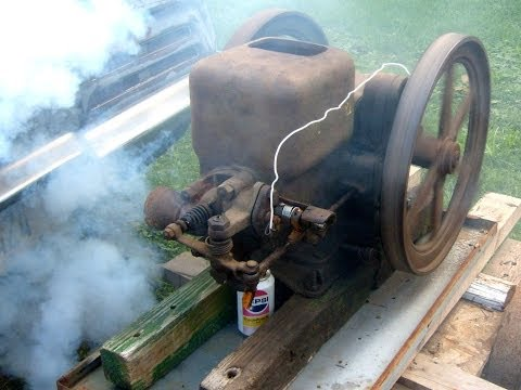 John Deere E hit & miss engine with rebuilt ignitor running good burning off excess oil in crankcase