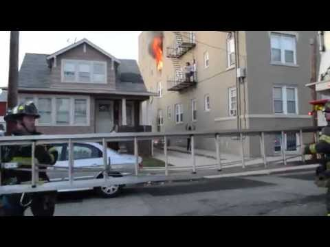 Early video: NJ apartment fire with fire escape rescue