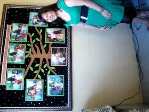 Stef in front of family tree pictures