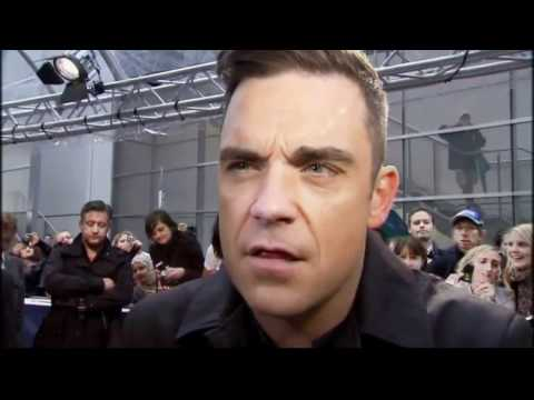 Robbie Williams makes 'sick' noises Music Videos