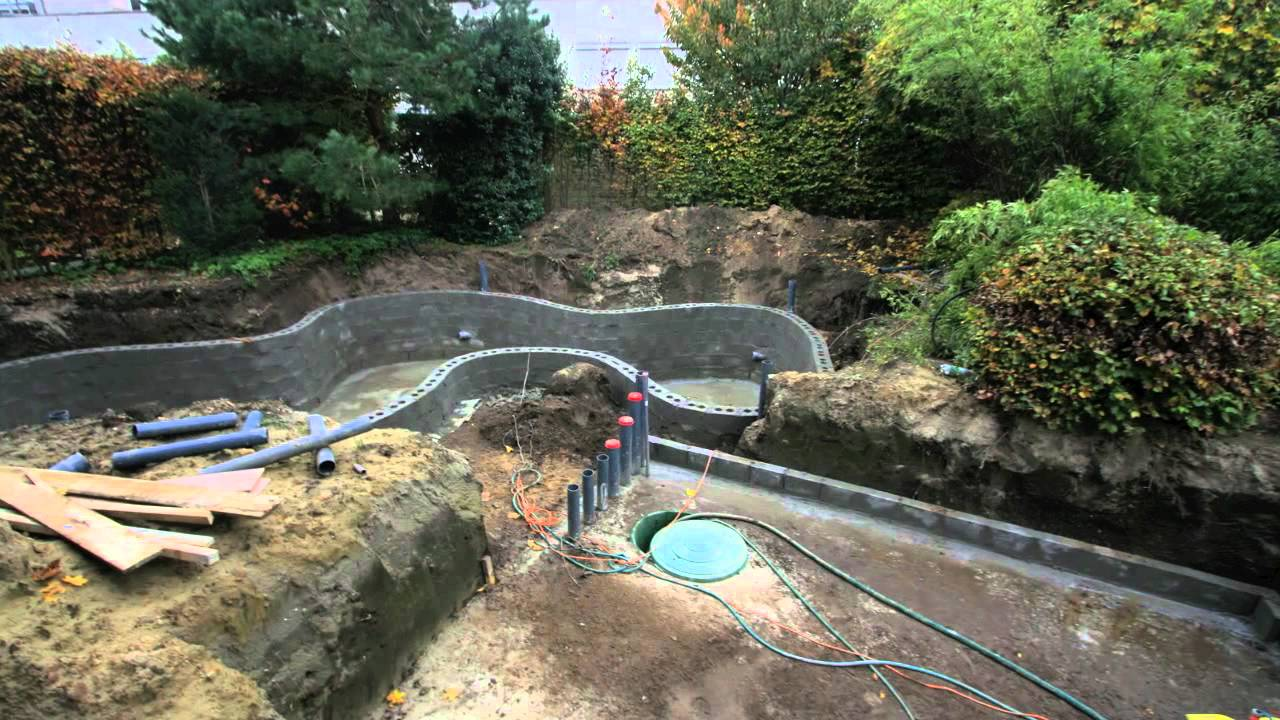 Making a koi pond koi pond construction youtube for Building a koi pond
