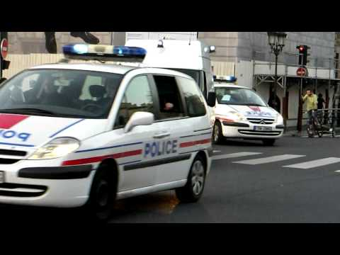 Police Escort with prisoners leaving the Palais de Justice Music Videos