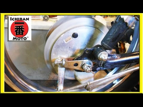 how to inspect, replace, upgrade  and adjust vintage motorcycle drum brakes on  a Honda café racer