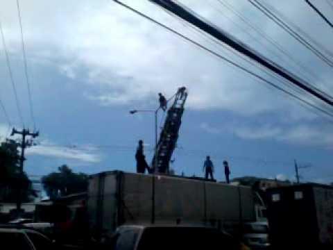 A man climbs an electric post in Mandaue City, Cebu
