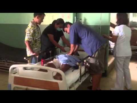 Doctors trying to save this man, in Palompon, Philippines