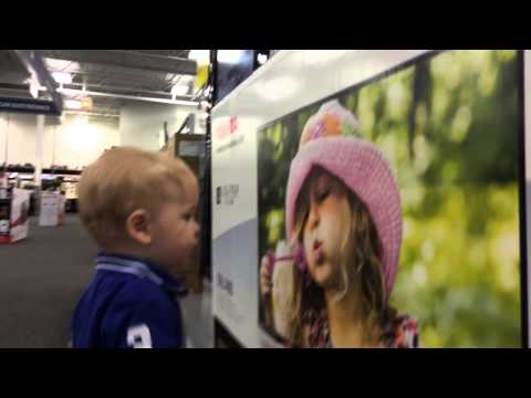 My son getting frisky at Best Buy.