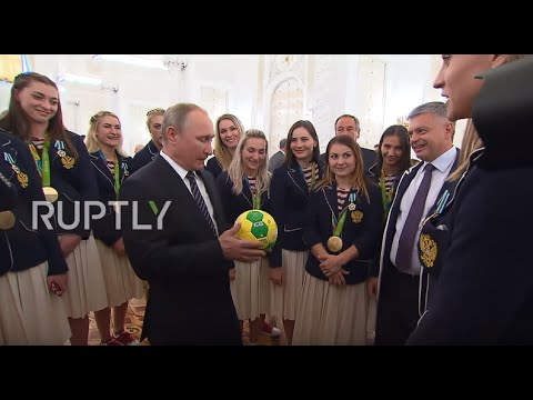 Russia: Putin receives special gift from Olympic Women's Handball team