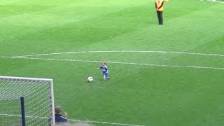 Crowd Cheers after Child Makes Goal