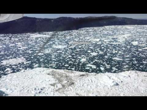 Fly low over the ice of Kangia Fjord in Ilulissat (2016 July)