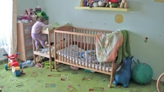 Teri escaping from the crib (17 months old)