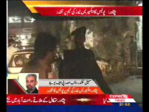 Pakistan police beating express new reporter in Peshawar