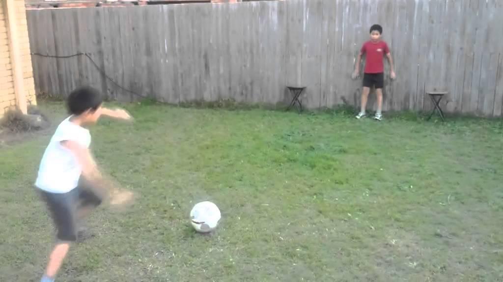 backyard football play soccer goal keeping kicking