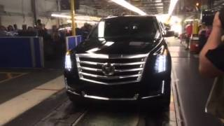 Governor Perry drives 2015 GM SUV off the line.