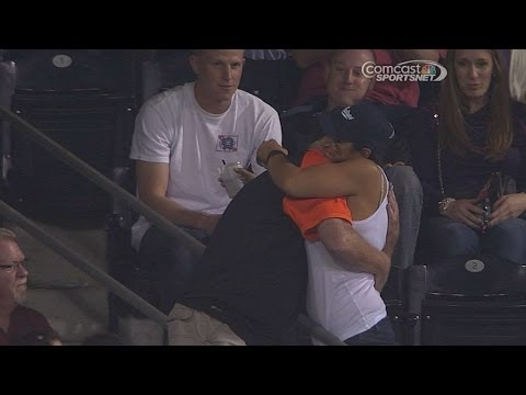 Giants fan misses foul ball, hugs Padres fan
