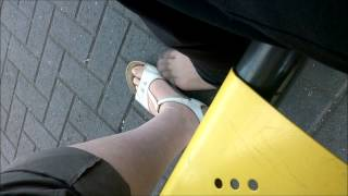 cd wearing tights playing footsie with woman at bus stop