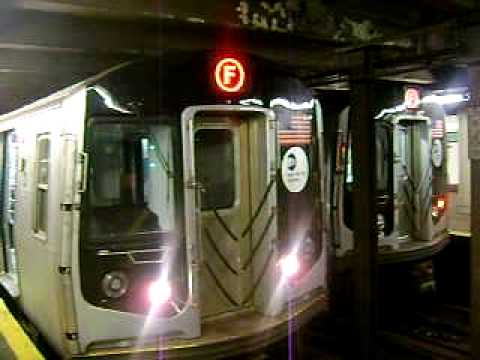 MTA New York City Subway R-40M/R-42 F train and R-160 E and F Train Arriving at Forest Hills-71 Av