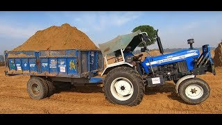 New holland 3630 tx super tractor performed with loaded trolley