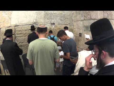 A mincha minyan (of ten or more Jewish male adults) at the Western Wall, Jerusalem Old City, Israel