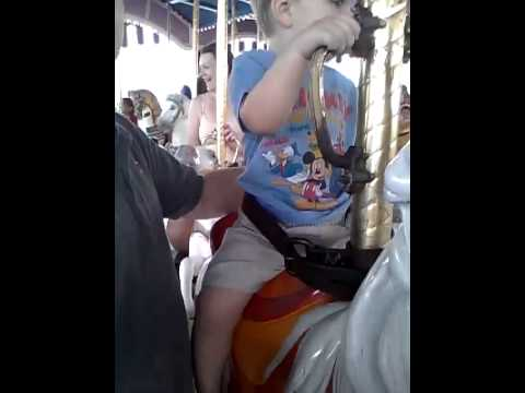 Samuel's first ride on the Carousel at Magic Kingd