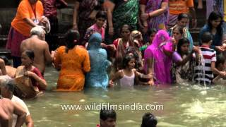 Pilgrims bathe in sacred Godavari River Kumbh Mela Nashik