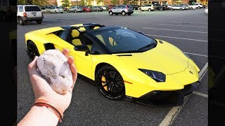 guy throws rock at lamborghini...