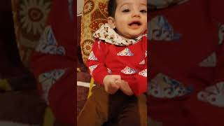 Funny baby cute boy laughing