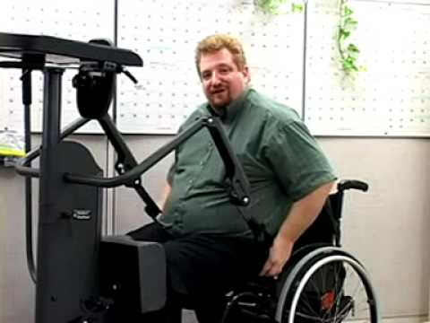 A paraplegic shows how to use a StrapStand standing device