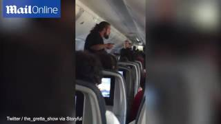 Passenger removed from plane by police after flight forced to divert