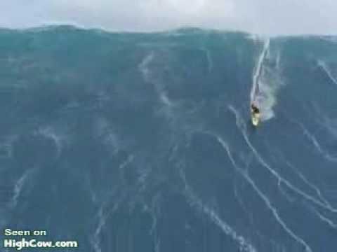 Surfer caught in a huge tidal wave.