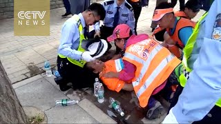 Dozens of Dalian Marathon runners collapse
