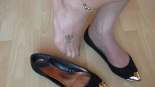 pointy flats, nylons and tattoos, shoeplay and dangling