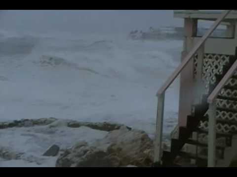 Hurricane Earl St. Maarten - Waves pounding shore line near homes