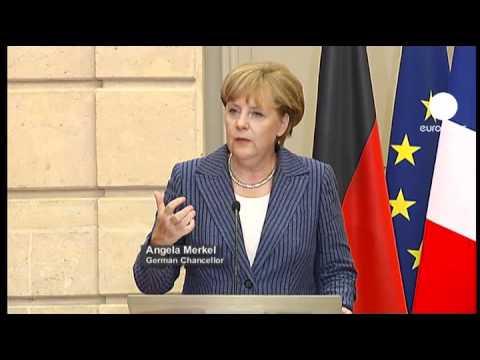 Sarkozy, Merkel urge closer euro economic governance